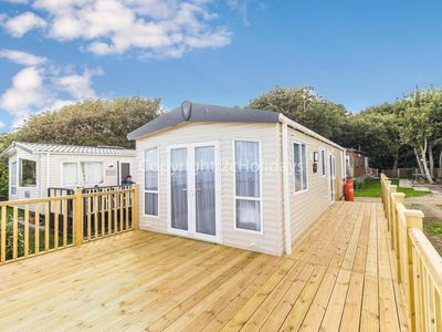 Photo for 6 berth luxury caravan for hire with a full sea view & stunning views ref 32069