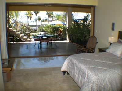 Studio suite looking out to dining area,pool, and views of golf course and ocean