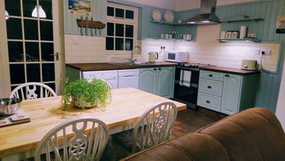 Spacious, fully equipped kitchen with large dining table