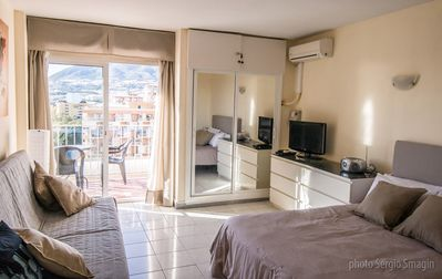 Photo for POOLS WITH TOBOGANES, AC, WIFI, BEAUTIFUL VIEWS AND BEACH AT 400M.