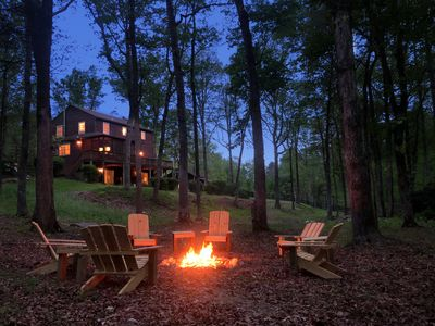 Fire pit with comfortable Adirondack chair seating
