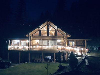 Photo for Custom Log Home -Outside fire pit , trails , and creek