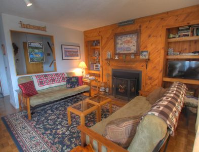 14 Snowside - a SkyRun Vermont Property - Cozy living room with fireplace