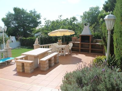 Photo for Spatious ground-floor in a two-flats house with terrace, barbecue and garden.