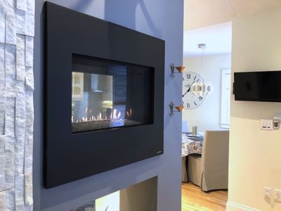 Dual-sided fireplace is visible from all angles.