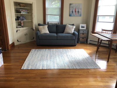 Den connected to living room, with sleeping sofa