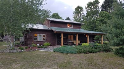 Photo for Quiet peaceful log cabin on 10 acres 1/2 hour from WI Dells