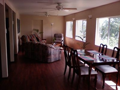 The living room and dining area have a panoramic view of the entire bay.