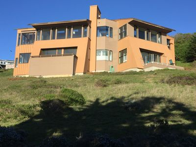 Back of beautiful 3800 sqft home, huge windows in every room with amazing views.