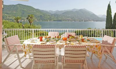 Photo for Exclusive waterfront villa with pool, private beach, big garden, lake view