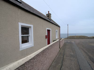Photo for Cosy cottage overlooking the harbour and magnificent view of the Moray coast