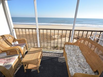 Photo for Cozy, inviting 1 bedroom oceanfront condo with free WiFi, coastal decor, and an enclosed porch with a gorgeous ocean view located uptown just steps to the beach!