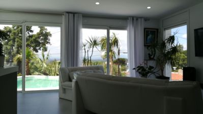 Photo for New villa standing quiet with views of Roses Bay