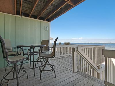 Photo for Lovely condo w/ bay views, shared pool - walk to the beach, snowbirds welcome!