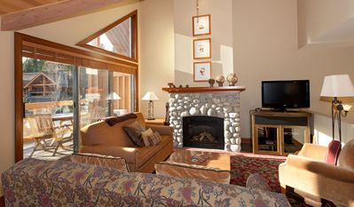 Cozy Living Room with Fireplace, Flat Screen TV on Second Level