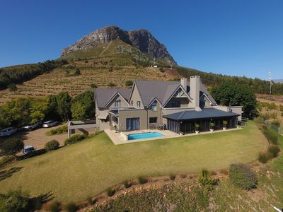 Photo for Luxury Villa on the slopes of the Helderberg Mountain with unbelievable views