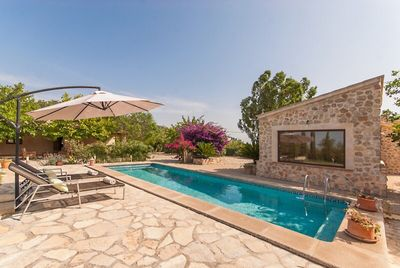 Swimming pool with sun loungers and parasol