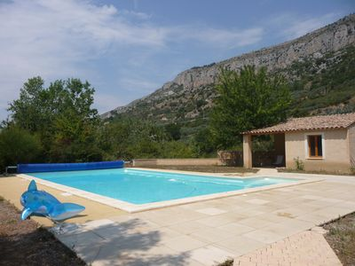 Photo for Beautiful stone Provencal farmhouse, surrounded by nature, beautiful view, west terrace, swimming pool