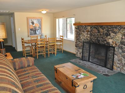 The living room, wood burning fire place, and dining area at Ski House