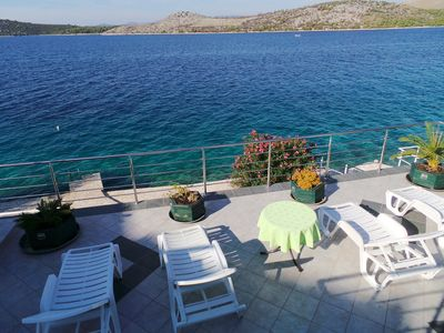 Photo for Holiday apartment facing the sea with terrace