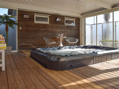 Photo for Comfortable house 200 m away from the beach. Terrace with Jacuzzi.