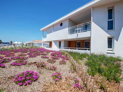 Photo for Get away to the Med | Bright + Comfy Apartment on the Beach