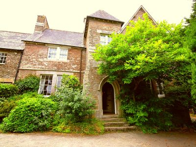 Photo for Manor House with gardens, hot tub & sea views, sleeps 16 to 21 with cottage