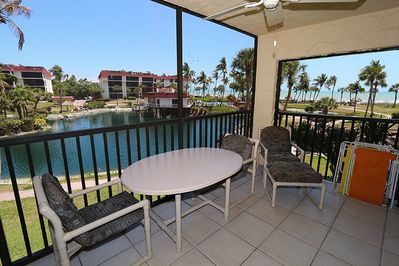 Screened lanai overlooking the Turtle Pond and Gulf
