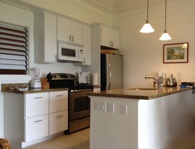 Updated kitchen with new appliances and granite counter tops