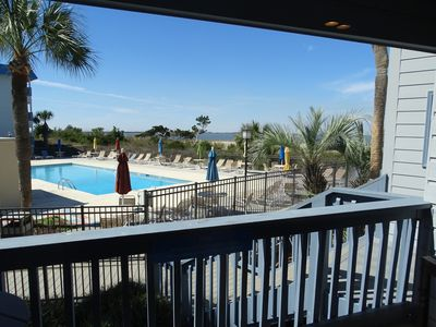 Photo for Newly renovated! Pool and beach just outside your condo!