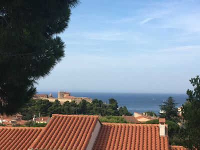 View over the red roofs of Collioure to the sea