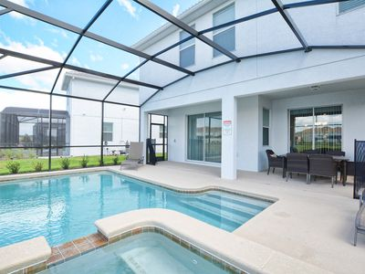 Photo for GREAT LOCATION, MINUTES TO DISNEY, LAKEFRONT,GAMEROOM,2 MASTER SUITES,FREE WIFI!