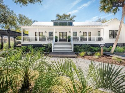 Photo for New Listing! Sunny 4BR w/ Saltwater Pool & 6-Seat Golf Cart Close to Beach
