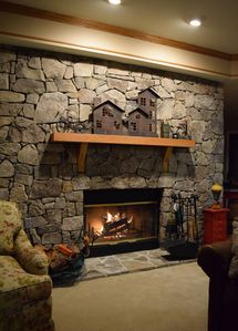 Free firewood and the stone fireplace are just two amenities at this condo.