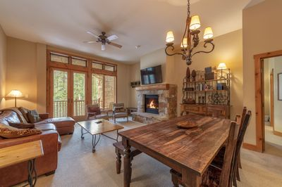 Main living room--stone fireplace, flat screen TV, private porch, Queen foldout.
