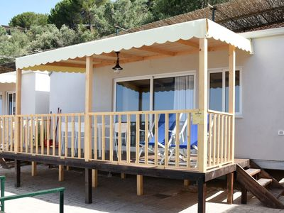 Photo for Chalet on park with beautiful view over the azure sea, directly on sandy beach