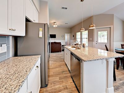 Kitchen - A large island offers plenty of prep space for home-cooked meals and seating for 2.