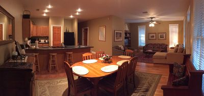 Open concept den, dining, and kitchen