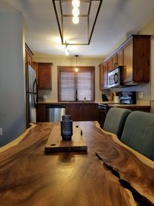 Photo for New !  1BR Condo with WIFI , King Bed, Parking, Private Deck with BBQ in Nature!