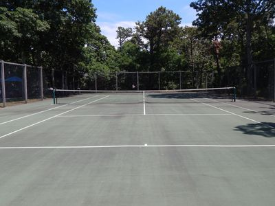 Private tennis court for practice and match play (next to pool)