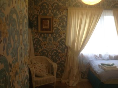 Twin bedroom with views over to Dalquarin castle.