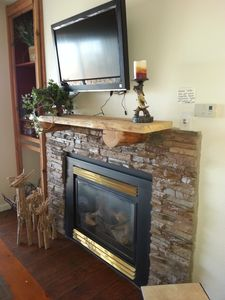 Fireplace and flat screen tv provide a relaxing atmosphere after a full ski day.
