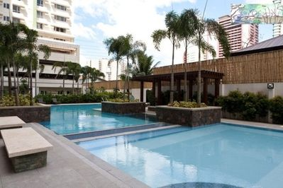 DE-STRESS by enjoying a dip in the pool with the property's tropic landscaping after a full-on day!