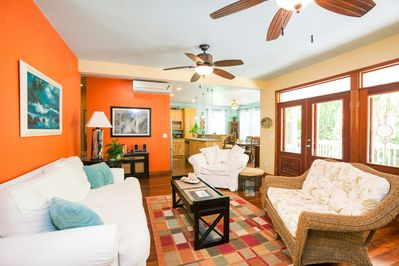 The living room opens up to the kitchen and the spacious screened-in porch