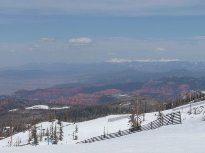 Blue (intermediate) & black (challanging)slopes with red rock country behind.