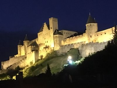 View of castle from house at night