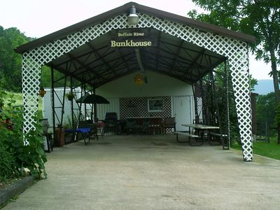 Entrance to Bunkhouse is a large covered pavillion for lounging or parking.