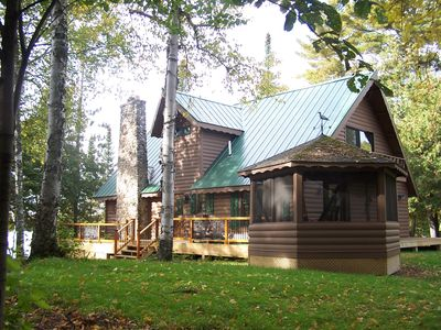 Another side view of our cabin with decking and gazebo