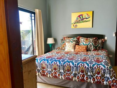 Warm and sunny bedroom with comfy king-sized bed with memory foam mattress.