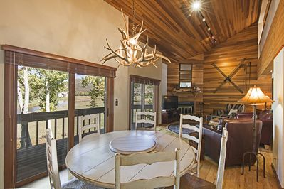 Open Living Room/Dining Area with Beautiful Wood Finishes and Amazing Views!